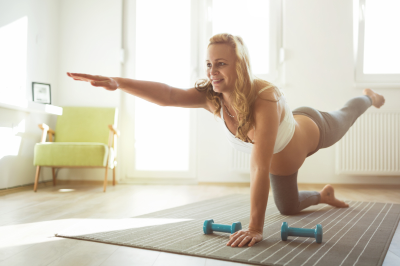 Exercising pregnant woman at home